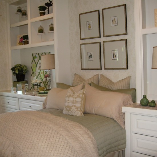 Bookshelves can frame a bed and add interest to the entire wall