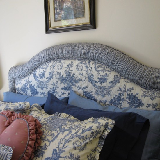 Consider a padded headboard to tie in with the design scheme